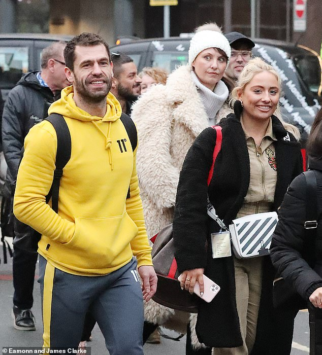 Shocker!The group were spotted outside the airport and clustered into a group as it was revealed they were waiting 30 minutes for their coach to arrive