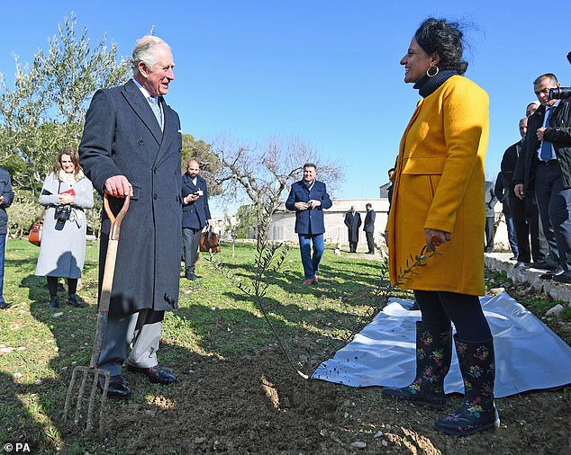 The Prince of Wales takes part in a planting ceremony during a visit to a traditional olive grove and fruit orchard in an historic convent in Bethlehem