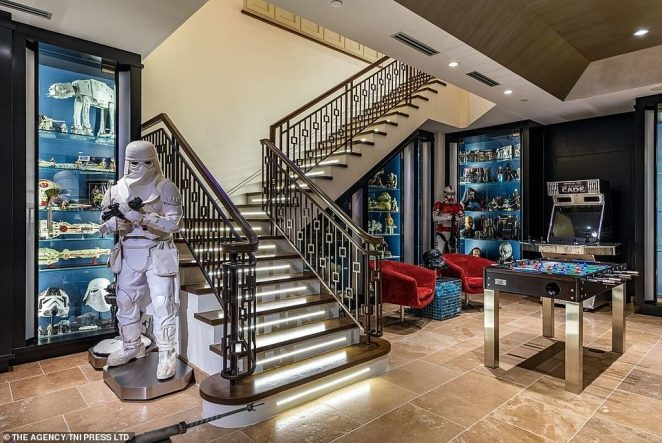 A stormtrooper can be seen guarding the cabinet and staircase, alongside a small games room complete with an arcade machine and foosball table