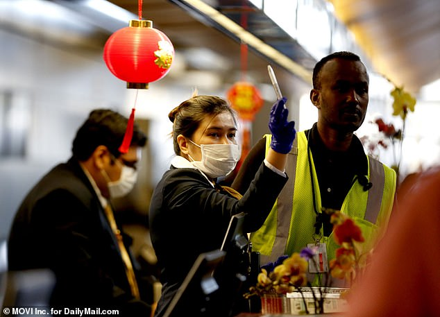 Arriving passengers from Asia, airline staff and airport staff at the Los Angeles International Airport take precautionary measures donning face masks