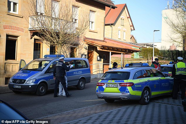 Police swoop in on the area in the southwestern German town of Rot am See, Baden-Wuerttemberg, where six are believed to have been shot dead