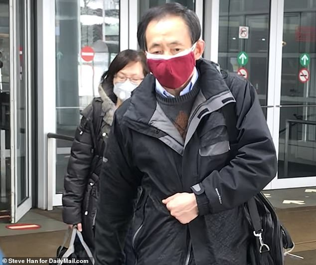 According to the Centers for Disease Control and Prevention, the woman traveled to Wuhan in late December and arrived back in the US on January 13. Pictured: Passengers wearing masks arrive at O'Hare International Airport, Thursday