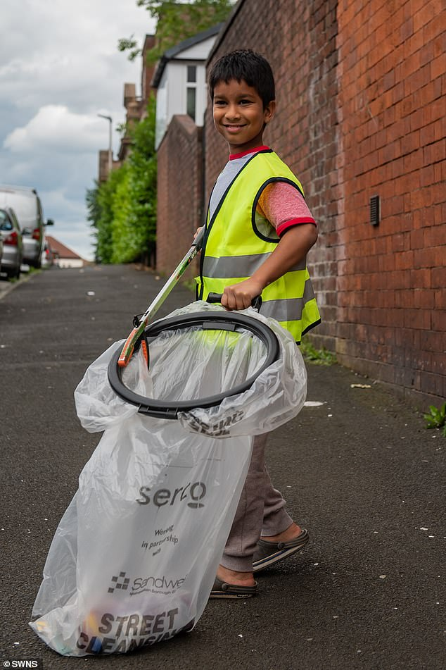 Nine-year-old cleanliness champion Umar Habib-Khan pictured in Smethwick, Birmingham. He was awarded Junior Litter Champion of the Great British Spring Clean competition