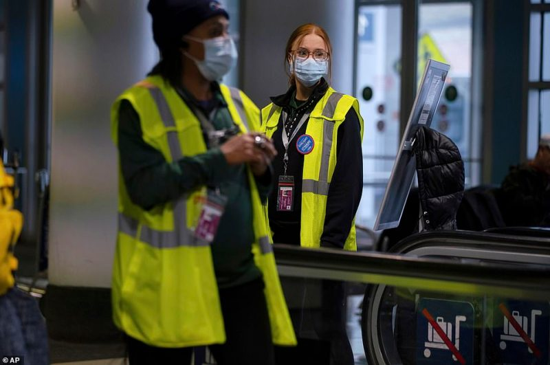 Tensions have been high at US airports as travelers worry about exposure to the virus in such a high-traffic, confined environment. Staff at O'Hare International Airport in Chicago are seen wearing face masks on Friday
