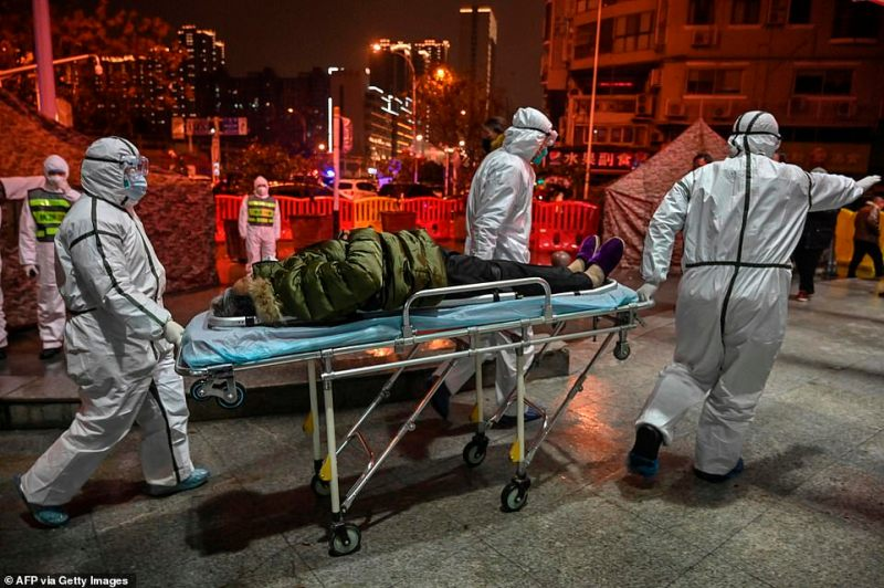 China's president Xi Jinping has warned the virus is accelerating as Chinese cities remains on lock down. A patient is pictured above being rushed to Red Cross hospital in Wuhan today. People have been pictured lying in the street after collapsing