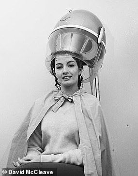 Christine is pictured above in a hairdryer applicance