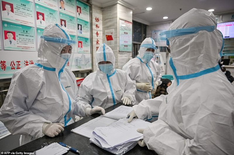 Coronavirus is now reported to have infected more than 1,280 people in several countries. (Medical staff wearing protective gear in Wuhan Red Cross Hospital today)