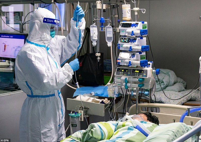 A man pictured on a drip in the Intensive Care Unit of Zhongnan Hospital of Wuhan University on Friday. China is frantically fighting to contain the virus