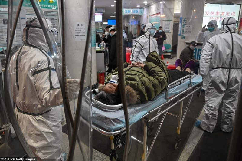 There are 200 to 300 Britons stuck in Wuhan, it has been estimated, including teachers and businessmen. Pictured above is a patient in the Wuhan Red Cross hospital