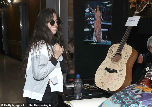 But since it's also all about giving back: The Grammys Charities Signing event continued with pop superstarlet Camila Cabello stopping to sign memorabilia