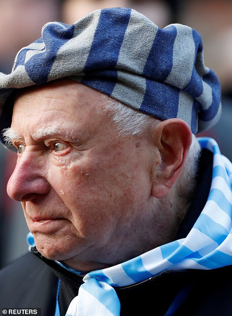 Tears can be seen on the cheek of an elderly gentleman - one of the hundreds liberated from the Nazi camp 75 years ago
