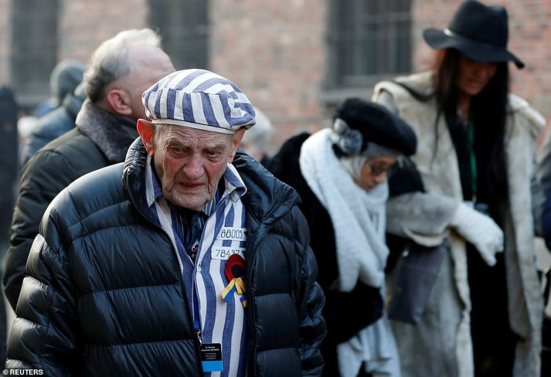 Survivor Igor Malicki, in his nineties, arrives to attend a wreath-laying ceremony at the 'death wall' at the camp. Many of the survivors who visited the camp were aged from 75 - an elderly woman who was born in the camp - to 101