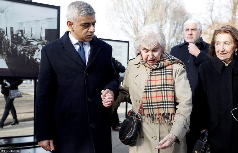 Mayor of London Sadiq Khan can be seen with Holocaust survivor Renee Salt as they arrive to attend the ceremony of unveiling a plaque informing about financial support of London to the Auschwitz-Birkenau Foundation during the ceremonies marking the 75th anniversary of the liberation of the camp and International Holocaust Victims Remembrance Day, in Oswiecim, Poland