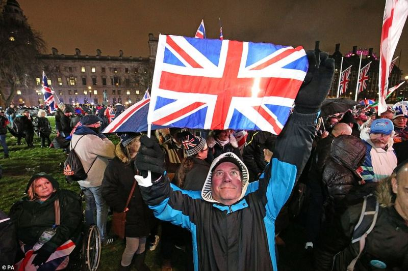 Happy Brexiteers were out in force in Parliament Square tonight as the clocked ticked down on the UK's time in the EU