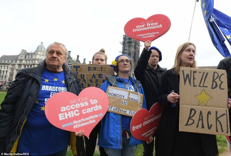Not everyone is celebrating, with vigils planned by pro-EU supporters (pictured, Remainers hold placards at Parliament Square)
