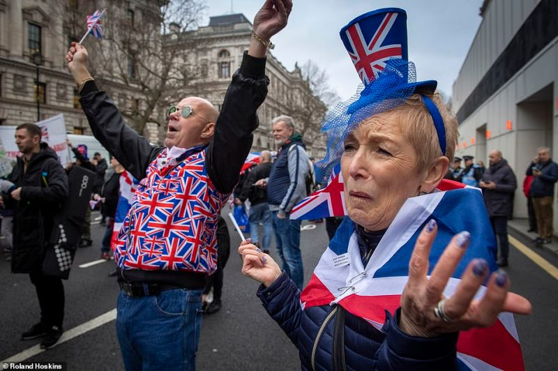 Brexit supporters gathered outside parliament on Friday to cheer Britain's departure from the European Union following three years of epic political drama