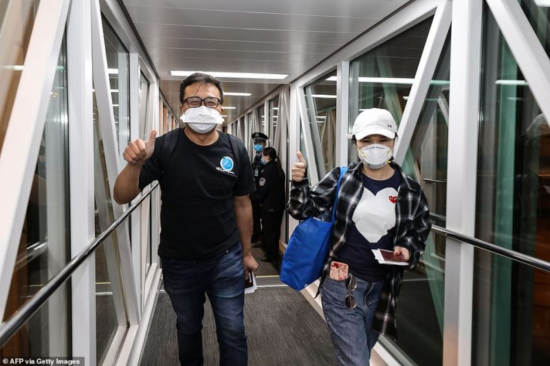 This photo taken on January 31, 2020 shows people disembarking from a Xiamen Airlines plane after arriving from the Thai capital Bangkok at Tianhe airport in Wuhan in China's central Hubei province