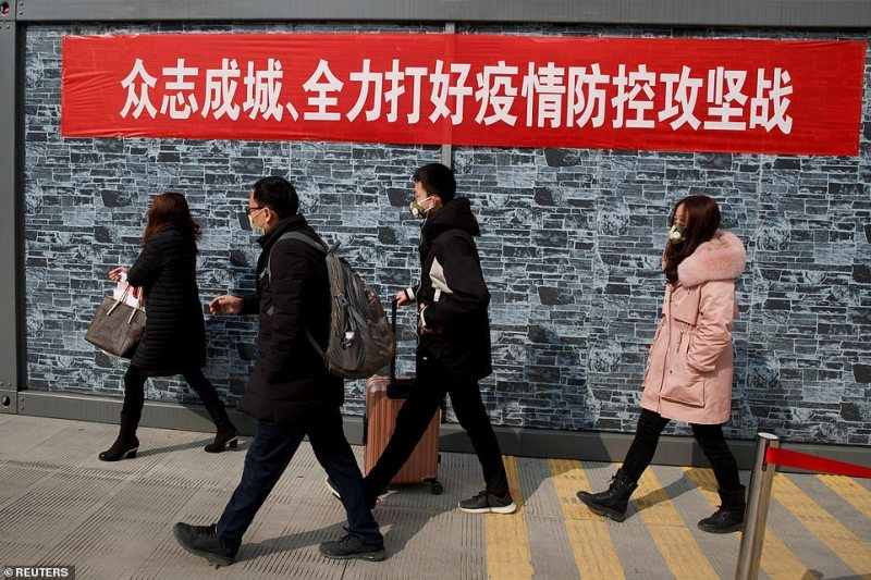 People coming from the Hubei province walk into Jiujiang after passing through a checkpoint at the Jiujiang Yangtze River Bridge, Jiangxi province, China, as the country is hit by an outbreak of a new coronavirus