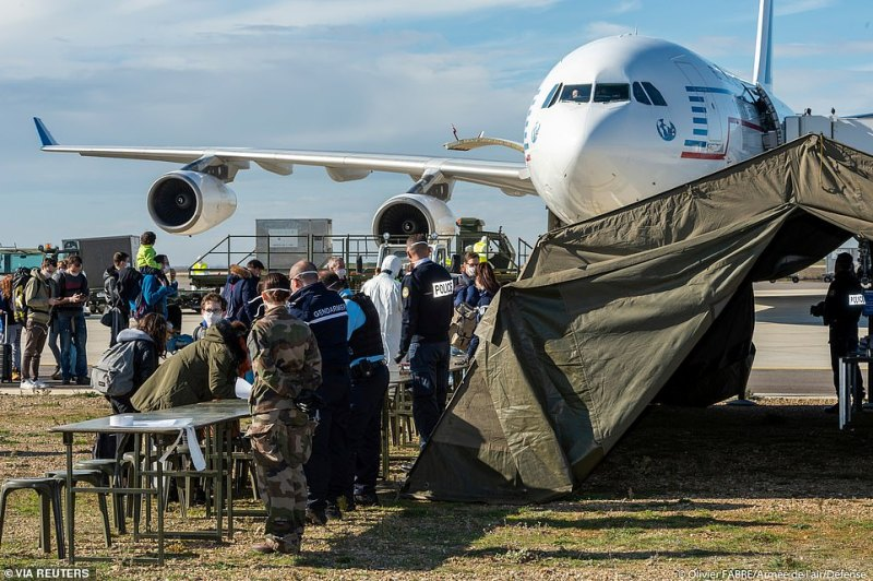 A plane carrying French nationals repatriated from Wuhan, China, amid the new coronavirus outbreak, lands at Istres Air Base, near Marseille, France today