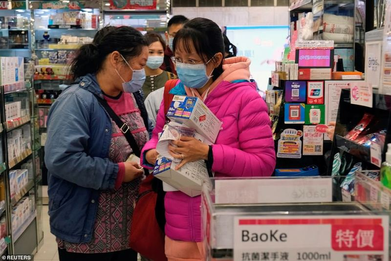 Customers queue in a store in Hong Kong to buy surgical masks. Employees in China are being urged to work from home and cease non-essential business travel in the first week of February