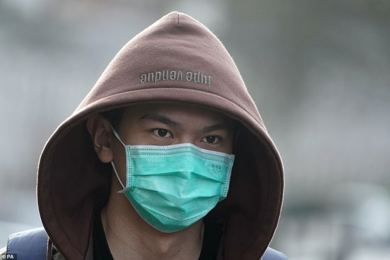 A man wears a mask in Newcastle upon Tyne, near where two patients who have tested positive for coronavirus elsewhere in England are bring treated in the city's Royal Victoria Infirmary's high consequence infectious disease unit