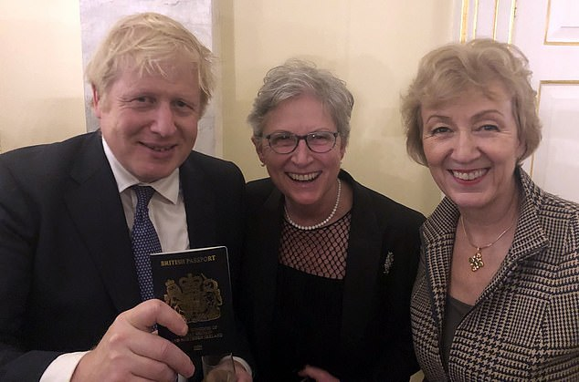 Earlier on Friday, Business Secretary Andrea Leadsom (right) tweeted a photo of Mr Johnson showing off his new blue British passport to former Labour MP and Vote Leave campaigner Gisela Stuart (centre)