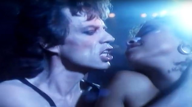 Raunchy: Jagger gets close to Rae Dawn Chong in the video for his 1985 track Just Another Night. She later complained that he was 'licky' on the shoot