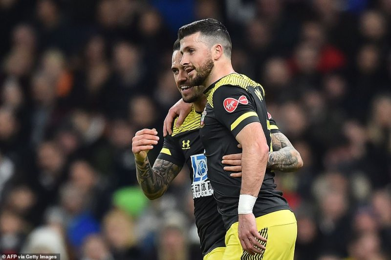 Long celebrated with Ings as Southampton found a route back into the final FA Cup fourth round replay on Wednesday