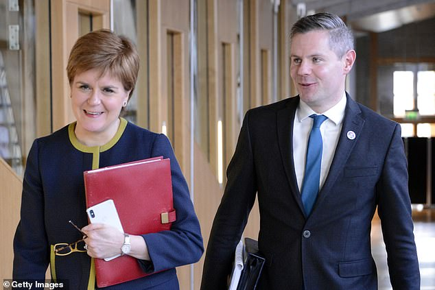 The boy's mother, 37, has called for Nicola Sturgeon (with Mr Mackay in February last year) to sack the MSP for Renfrewshire North and West