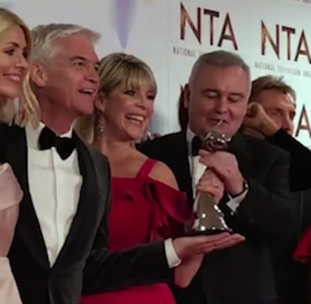 Tense:Eamonn was been accused of 'snatching' This Morning's NTA gong out Phillip's hand at the awards bash last week
