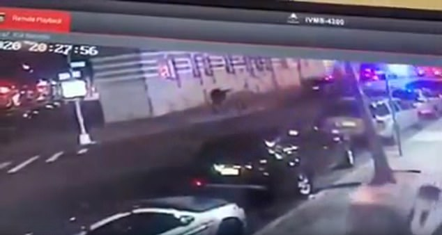 Man is seen raising his gun and firing on cps in security camera footage