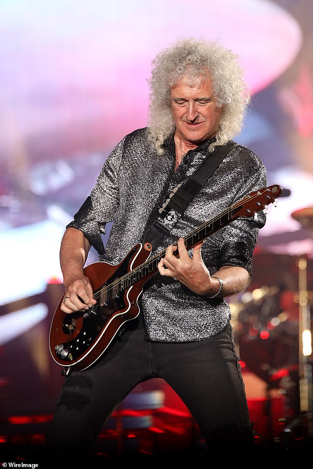 May performing with Queen and Adam Lambert in Auckland during their Rhapsody Tour