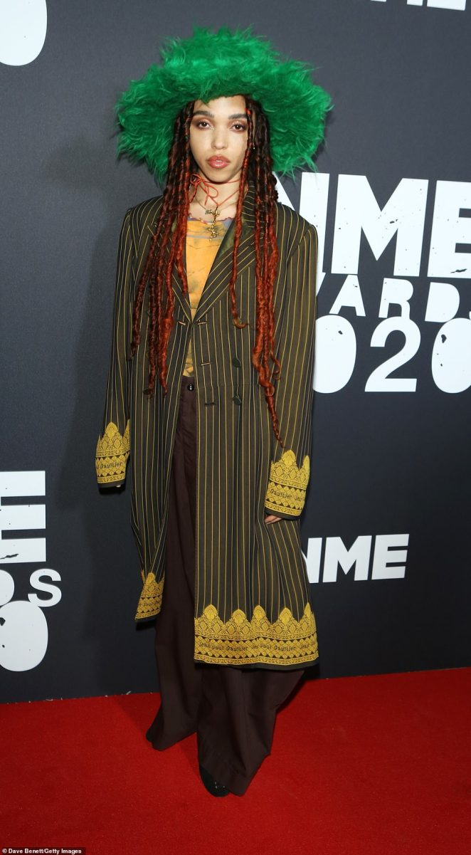 Edgy:Also in attendance was FKA twigs who showed off her quirky fashion sense in dark green pinstripe coat with a gold patterned detail