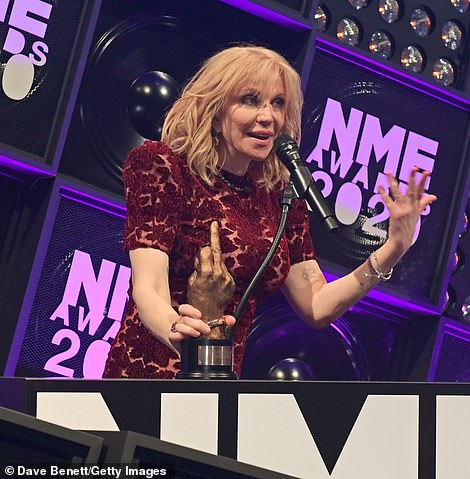 Honoured: Courtney, best known for fronting the rock band Hole, looked thrilled as she accepted her Icon award