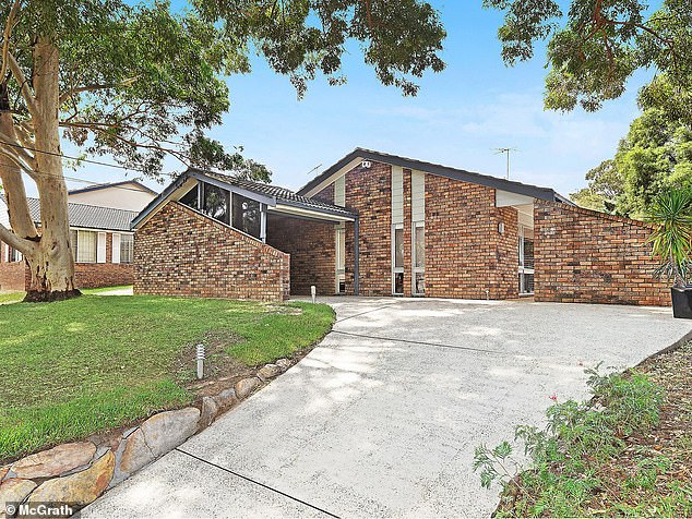 Domain is particularly upbeat about Sydney, predicting a 10 per cent increase this year in the mid-point value for houses.A home with a backyard in Sydney typically sold for $1.14million in December 2019 but should those predictions materialise, median prices would surge to $1.25million by year's end. Pictured is a house for auction in Carlingford with a reserve price of $1.43million