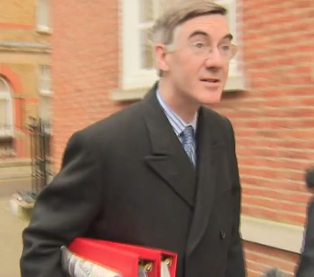 Jacob Rees-Mogg tried to deflect questions from reporters about his future by chatting about the weather as he left his London home - although he is thought to be safe