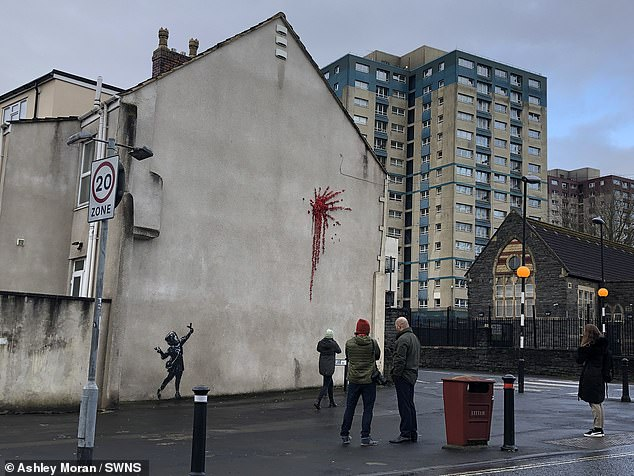 The mural appeared in Marsh Lane, Bristol, yesterday morning, on the side of a house