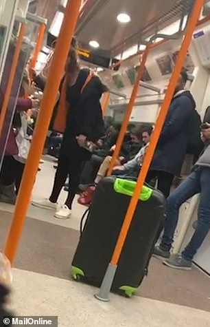 She threatened other London Overground passengers, before throwing a bottle of gin in his face as she got off