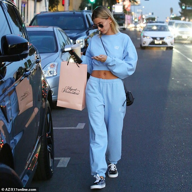 Private admission: Hailey's shopping trip came a day after her husband bragged that they have sex 'all day' while previewing his new album Changes in London