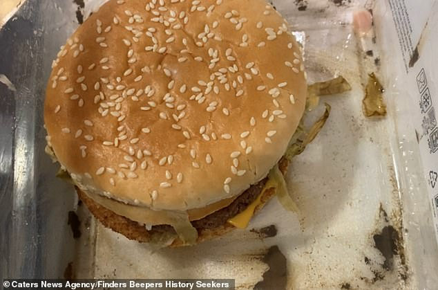 With help from his friend Andy Thompson, the father-of-three placed the meal complete with fries and a milkshake in a Tupperware container, pictured: the buried burger