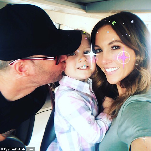 Shock split: Sadly, the pair announced their separation on Wednesday after seven years of marriage. They split five months ago, but kept it under wraps. Pictured with daughter Kelsey Lee