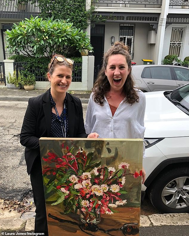 Ms Jones appeared elated as she posed with for a photo of police when her artwork was returned