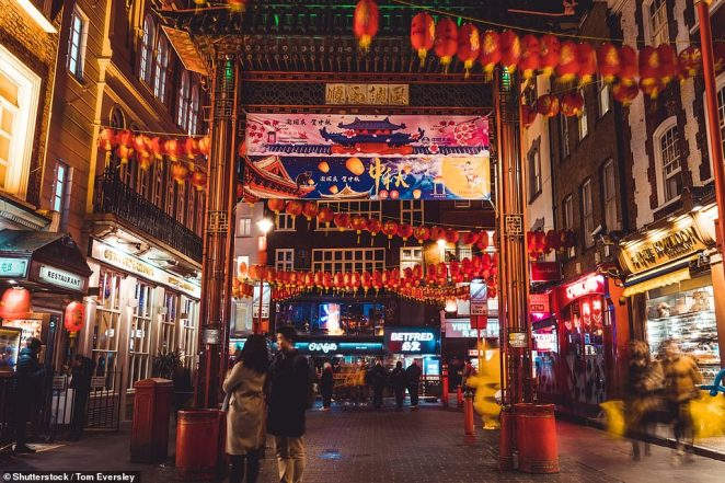 It comes as the ninth case of the disease, also called SARS-CoV-2, was diagnosed in Britain, making the first case in the capital. Pictured: Chinatown was a much busier scene last year
