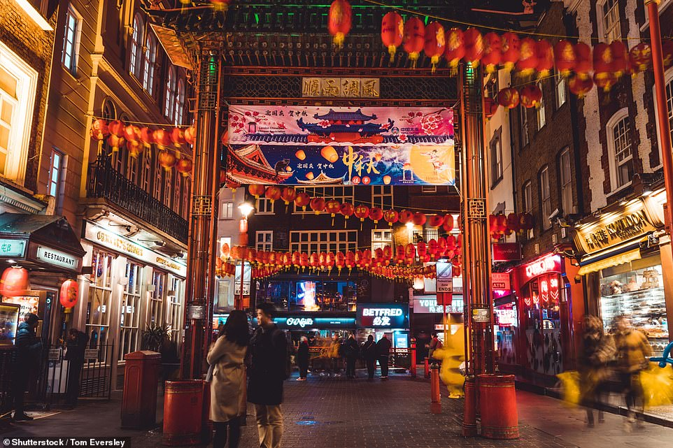 It comes as the ninth case of the disease, also called SARS-CoV-2, was diagnosed in Britain, making the first case in the capital. Pictured: China Town was a much busier scene last year