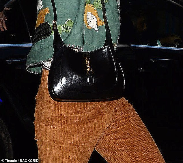 Stylish: Harry also has a penchant for Gucci bags and was seen carrying a smart black variation from the Fall Menswear 2020 Collection in February
