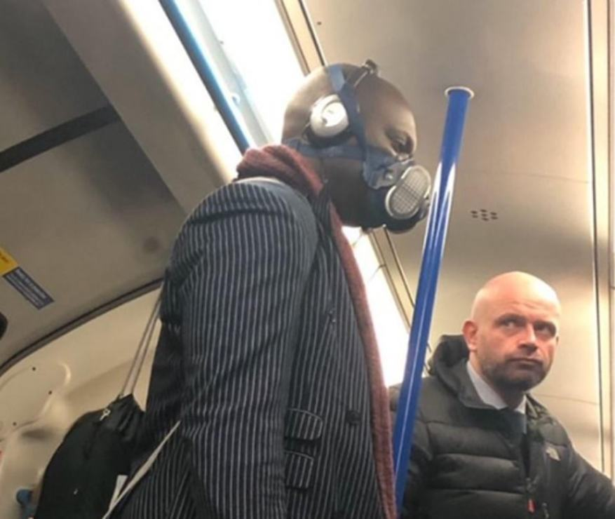 A tube-goer wears a face mask on a London underground train. It is unclear when the picture was taken, but it was posted on Twitter today with the caption: 'When coronavirus hits London'
