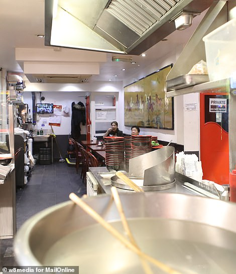 Wales market stall-holder Su Chu Lu had been to Taiwan – an island off the coast of China – to visit her family, but when she came back neighbours had turned on her. Pictured: Nearly deserted Chinatown restaurant.There is no suggestion that restaurant staff are infected by the virus