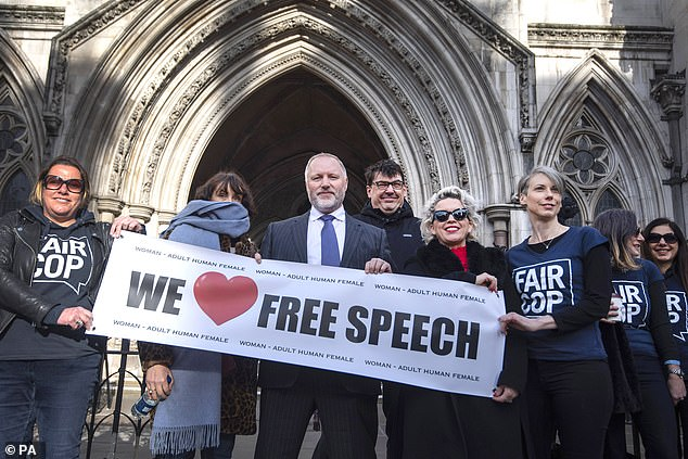 Mr Miller is the founder of campaign group Fair Cop, which challenges police interference in speech. The 54-year-old picture in the middle today holding a 'We love free speech' banner, with Father Ted writer Graham Linehan on his right