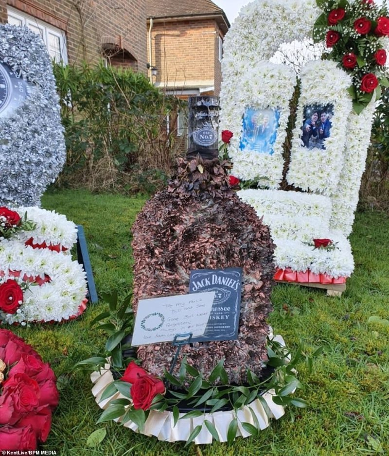 One of the floral tributes was in the shape of a bottle of Jack Daniel's whiskey, with a note that reads: 'To my pals Bill and Joe, Gone but never forgotten'