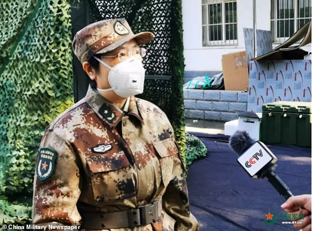 Chen and her team were already developing a quicker way to screen the COVID-19 coronavirus from a tent in the epicenter on January 30, according to an official report from China. She is pictured being interviewed by to a reporter from CCTV outside the mobile laboratory in Wuhan